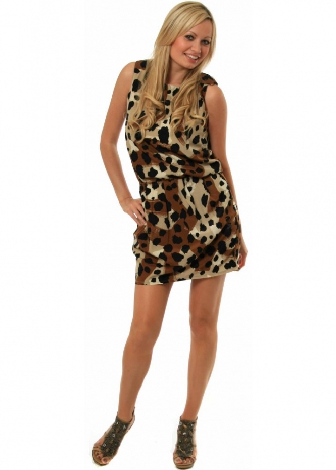 Thanks to the print's sartorial malleability, I think a leopard dress is a must-have staple in any fashion girl's closet. Plus, it's an iconic 90s throwback—reason enough to own one!