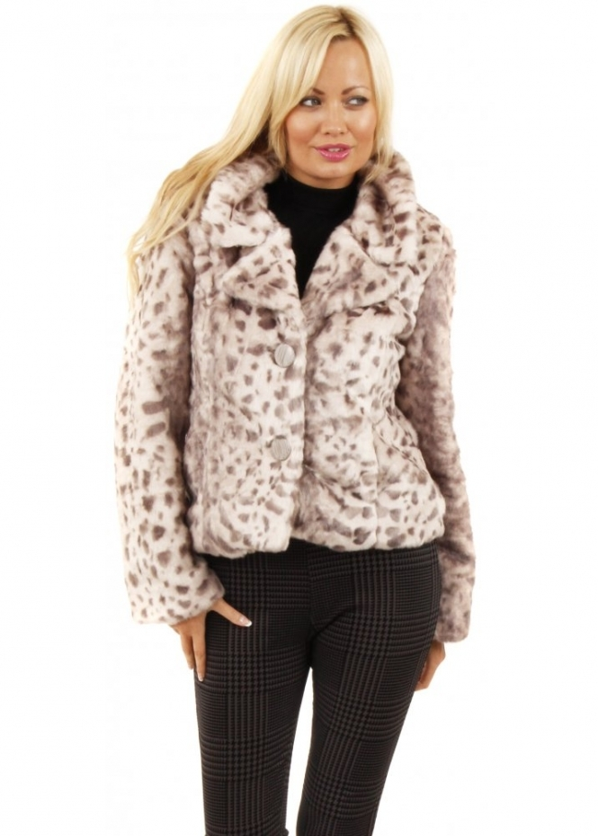 Leopard print has always been a classic in our book, and this season we went a little wild Body length: 24 1/2. Hits at hip. Acrylic/poly. Dry clean. Import.