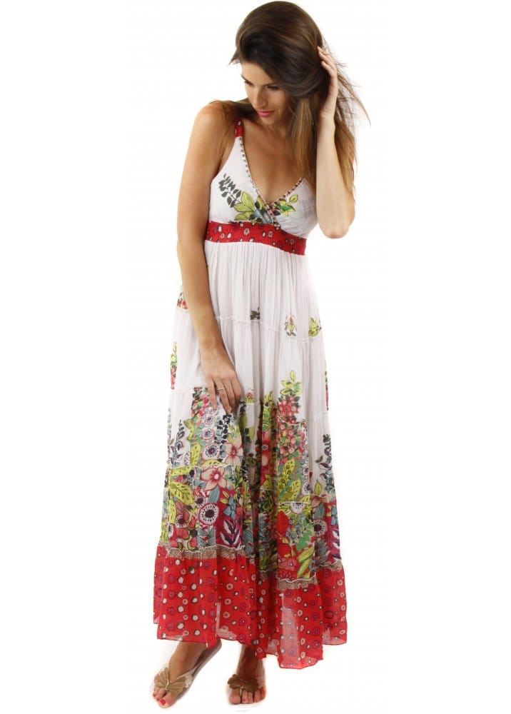 This stylish tiered maxi dress features a tropical print and a drawstring waist. % cotton. Gentle wash. Imported/5(54).