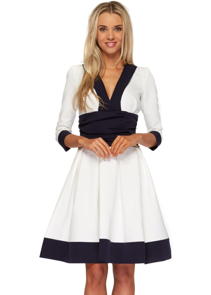 just unique cayla dress in white amp navy midi length