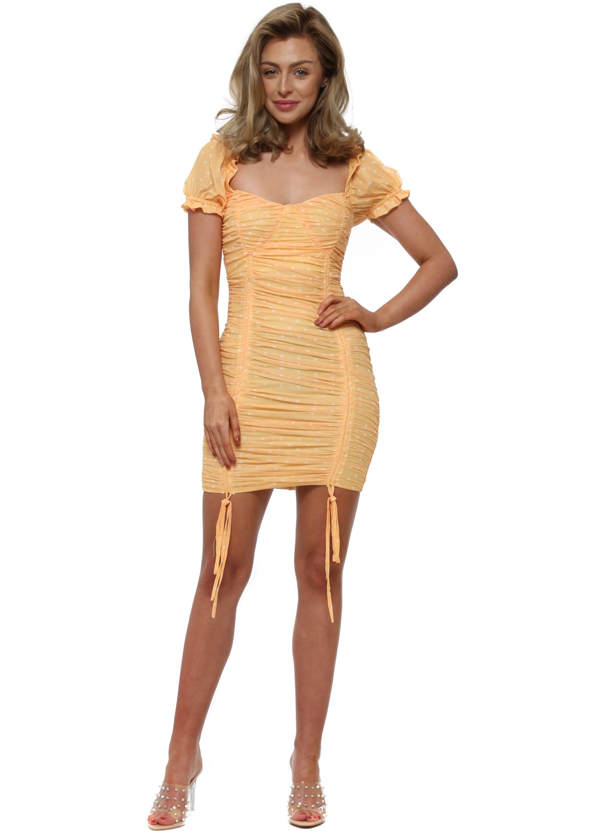 Polka dot rushed mini dress